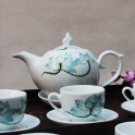 Bộ ấm trà cao cấp dáng chóp lửa vẽ sen xanh (Men trắng)