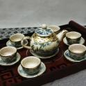 Bộ ấm trà dáng quả hồng bọc đồng (Men rạn)